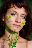 Young woman and flowers — Stock Photo