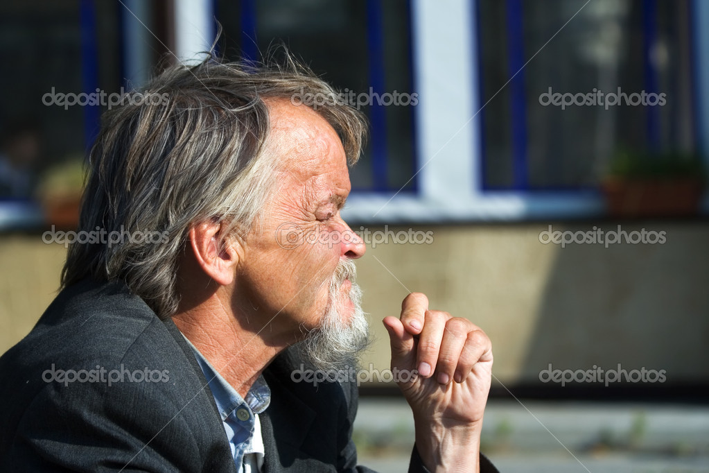Sad homeless old man on a city street — Stock Photo #6232854