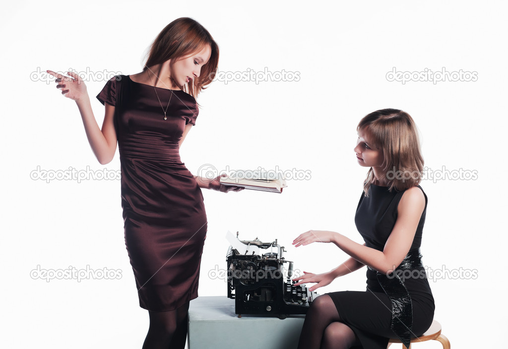 Two young retro secretaries with a typewriter. — Stock Photo #6258566