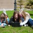 Teenage schoolgirls lying on a grass — Stock Photo