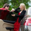 Young couple with a new car — Stok fotoğraf