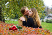 Happy young couple in a park — Stock Photo