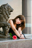 Sad young woman with a rose — Stock Photo