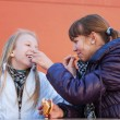 Stock Photo: Two teenage girls eating a burgers