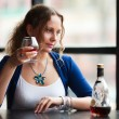 Young woman with a cognac — Stock Photo