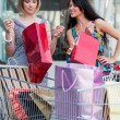 Two young women with shopping carts — Stock Photo #6294763