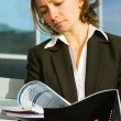 Businesswomreading reports — Stock Photo #6296531
