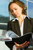 Businesswoman reading a reports — Stok fotoğraf