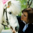 Young woman and a pony - Stock Photo