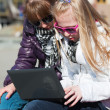 Stock Photo: Teenage schoolgirls using laptop