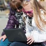 Teenage schoolgirls using laptop — Stock Photo