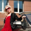 Young woman with a convertible — Stockfoto #6301219
