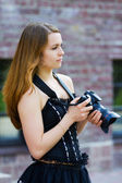 Young woman with a photo camera — Stock Photo
