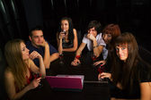 Young friends with laptop in a bar — Photo