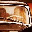 Royalty-Free Stock Photo: Young women driving retro car