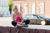 Teenage girl on a city street — Stock Photo