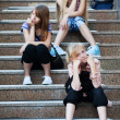 Royalty-Free Stock Photo: Teenage girls relaxing on a steps