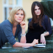 Stock Photo: Two young female students on campus