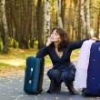 Thoughtful woman with a luggage — Stock Photo #6349573