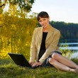 Happy young businesswoman with laptop — Stock Photo