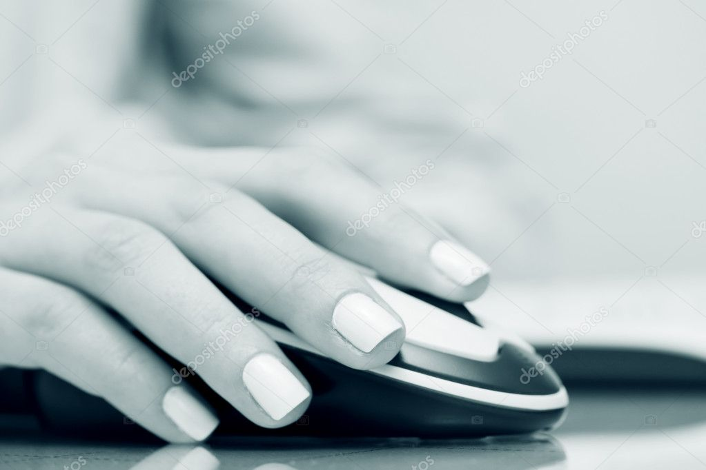Female hand holding computer mouse.   Stock Photo #6344702