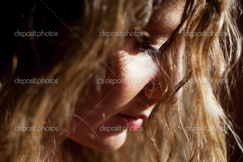 Close-up portrait of sad beautiful woman looking down — Foto de Stock   #6344860