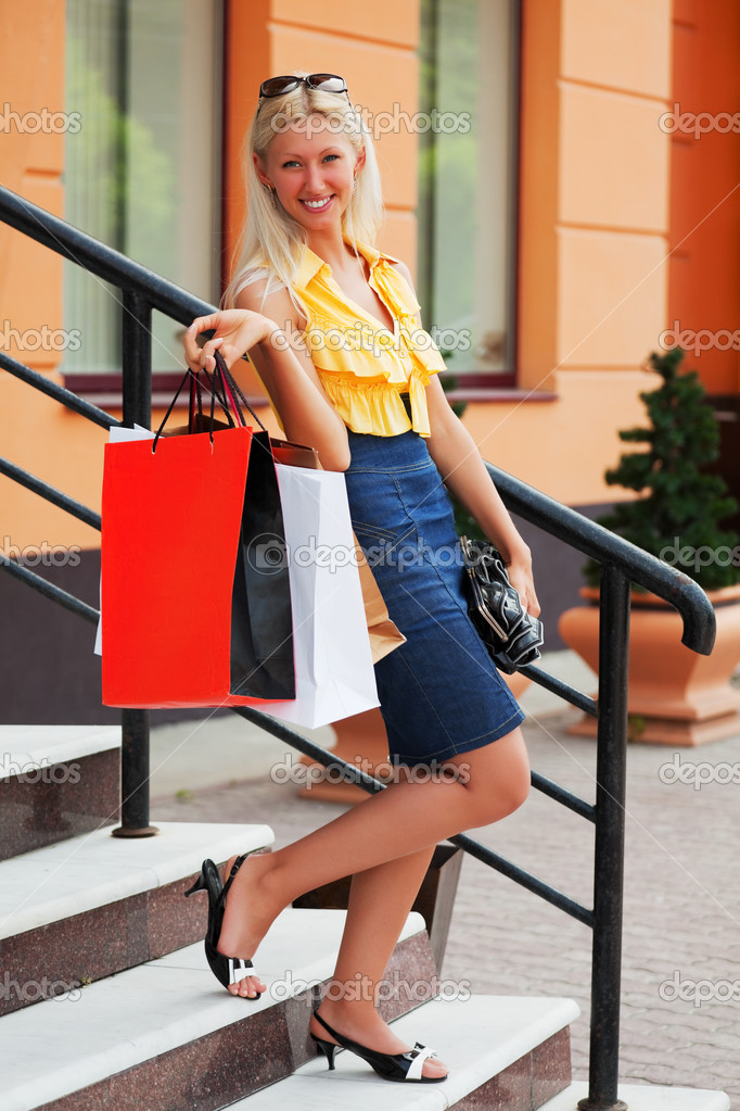 Young woman with shopping bags against of store window.  Stock Photo #6345391