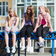 Teenage girls relaxing on a city street — Stock Photo #6350188