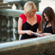 Two young students on campus — Stock Photo
