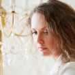 Woman against a chandelier — Stock Photo #6350299