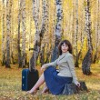 Young businesswoman with suitcase — Stock Photo