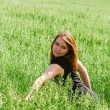 Young woman in a grass — Stock Photo