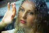 Sad woman and a rain — Stock Photo