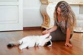 Woman and a cat — Stock Photo
