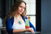 Young woman with a cocktail — Stock Photo