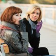Two young women sitting on a bench — Stock Photo #6364002