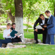 Young business in a city park — Stock Photo