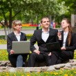 Young business with laptop in a city park — Stock Photo #6364056