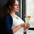 Young woman with a cocktail - Stock Photo