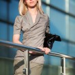 Young businesswoman on the steps - Stock Photo