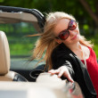 Foto Stock: Young woman with a car
