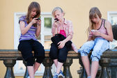 Teenage girls calling on the mobile phones — Stock Photo