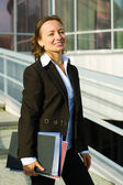 Happy businesswoman at the airport — Foto Stock