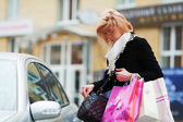 Shopper on a car parking — Stock Photo