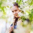 Stockfoto: Beautiful woman in a spring garden