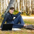 Young businesswoman working on laptop - Stockfoto