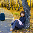 Sad woman with suitcase — Stock Photo