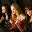 Three young women in a night bar — Stock Photo #6406651