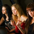 Three young women in a night bar — Stock Photo