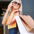 Happy shopper on the phone — Stock Photo #6406757